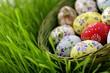 Leinwanddruck Bild - Easter egg in wicker basket