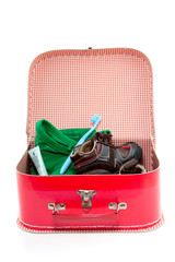 a colorful spare suitcase  with shoes and cloths isolated over w