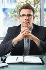 Executive in suit looking at camera