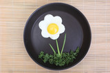 Flower shaped fried egg with greenery poster