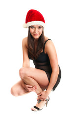 Young beautiful sexy woman in Santa`s hat