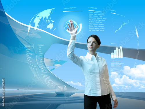 Attractive brunette with interface in futuristic interior