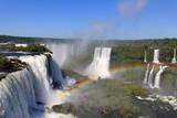 Fototapety Iguazu waterfalls with rainbow on a sunny day.