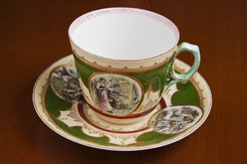 antique teacup on a wood brown table