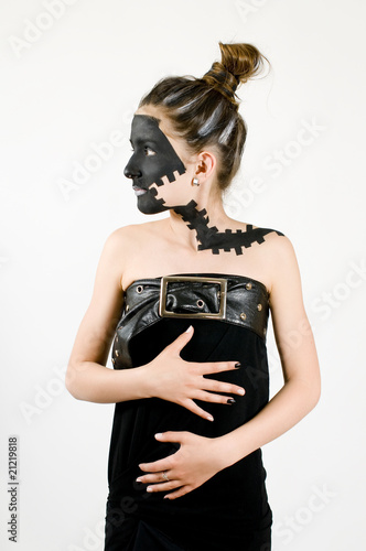 Teenage fashion girl painted black face