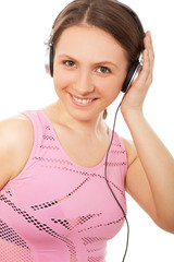 Young ladies in headphones listening to music