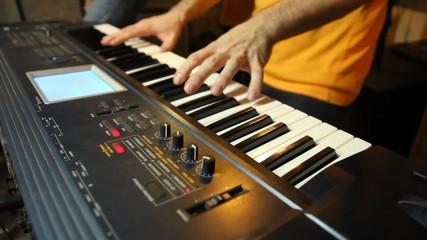 unidentified keyboard player playing in studio