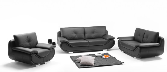 A view of a room with black leather sofa