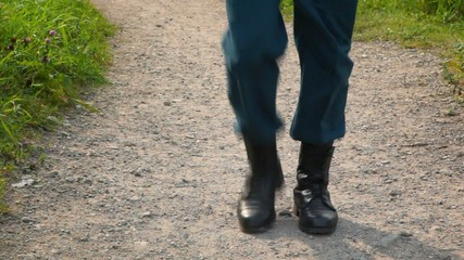 soldier in military boots march on the spot outdoors