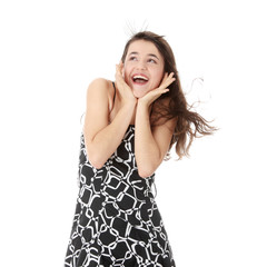 Beautiful teen girl in dress laughing