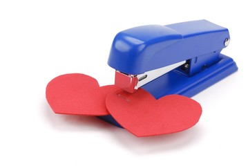 two hearts binded together by stapler