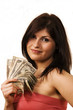 Pretty female holding used cash bills