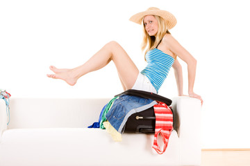 Girl packing for summer trip
