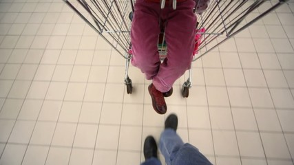 buyer with camera and shopping trolley going in mall