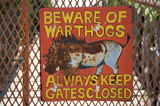 Beware of warthogs signboard in Harnas foundation poster