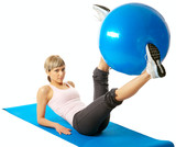 Sportswoman exercising with a Fitness Ball