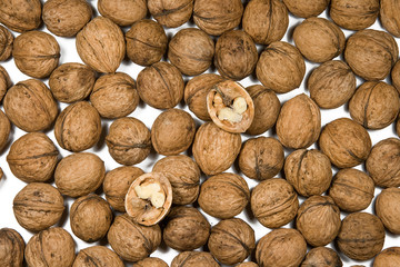 many walnuts are on a white background