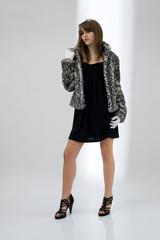 Fashionable teenager girl posing
