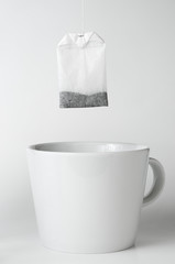 Teabag with white teacup
