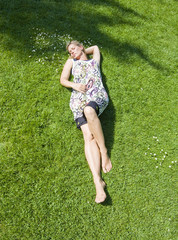 Aerial view of a woman relaxing in a park
