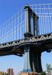 New York City bridge pillar with deep blue sky