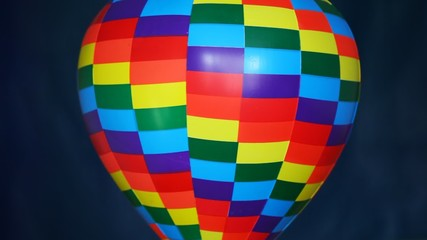 part of coloured toy air ball revolves on blue background
