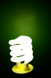 Compact Fluorescent efficient light bulb on green poster