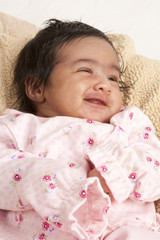 Portrait of a Smiling Newborn Baby Girl