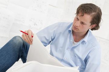 Mechanical engineer checking drawings