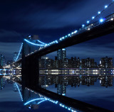 Fototapety Brooklyn Bridge and Manhattan Skyline At Night, New York City