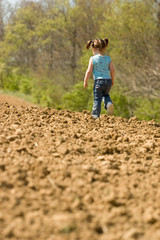 Young Girl Running on Field