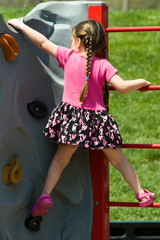 Child Climbing a Rock Wall