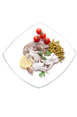 octopus with tomatoes and peas on dish