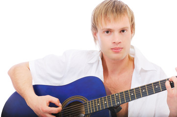 Beautiful young man plays guitar