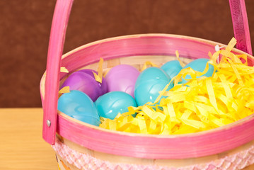Blue and Purple Easter Eggs in Basket
