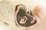 Fototapety Spa.Mud Mask on the beautiful woman's face