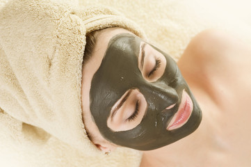 Spa.Mud Mask on the beautiful woman's face