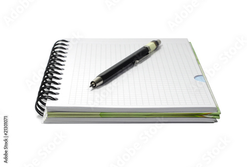 Notebook and black mecanical pencil isolated on white