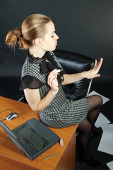 Girl-secretary is in an office