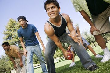 group of men playing football in park low angle view.