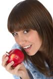 Happy teenager in pajamas eating healthy apple poster