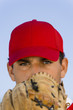 baseball pitcher holding glove in front of face (close-up) (portrait)