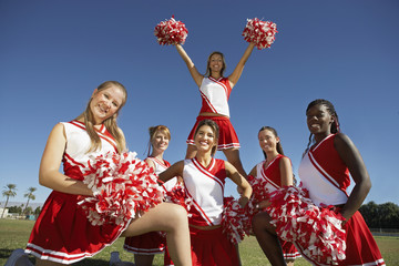cheerleading squad in formation on field portrait (portrait)