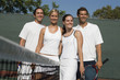 mixed doubles tennis players standing at net arms around