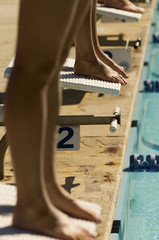 female swimmers on starting blocks (low section)