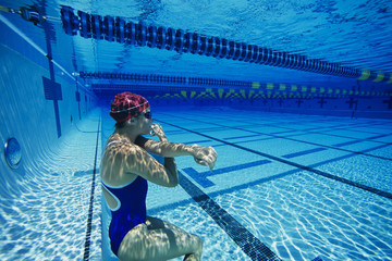 female swimmer resting underwater