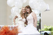 bride and friend standing together holding balloons at bridal shower
