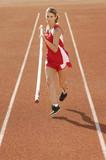 athlete running with pole vault