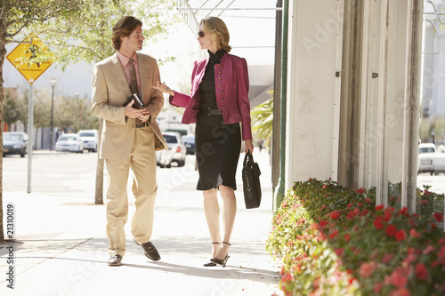 businesspeople walking in street