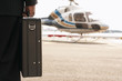 businessman with briefcase on helicopter pad